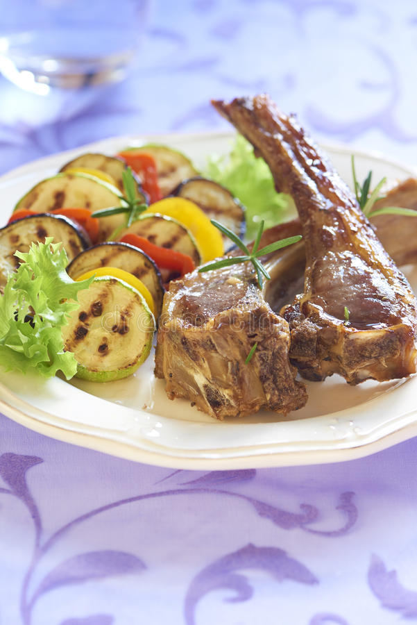 Fried lamb with vegetable garnish stock photography