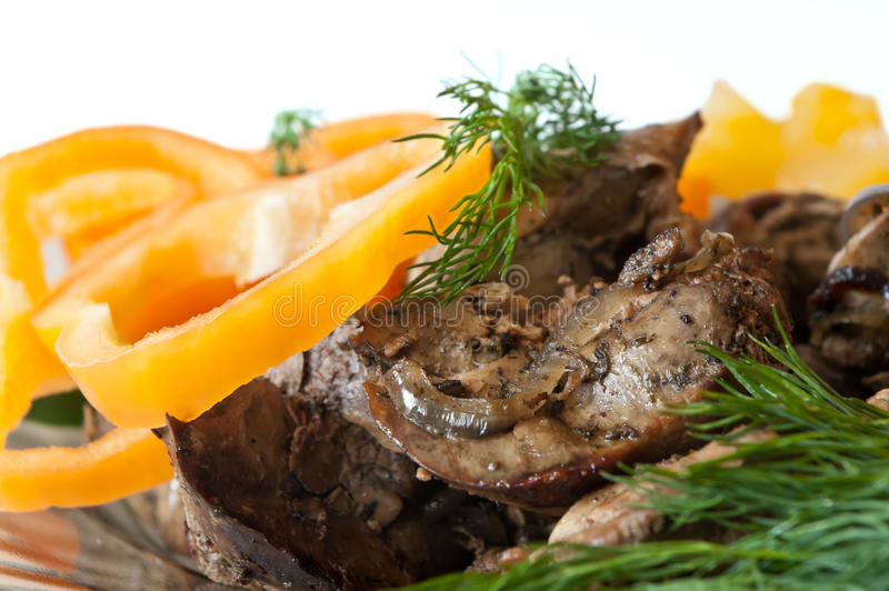 Fried liver. Dish wiht fried liver with sweet pepper and fennel royalty free stock photography