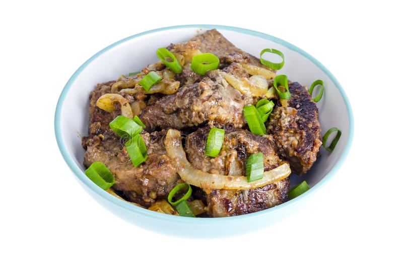 Fried liver with onions in bowl on white background. stock photography
