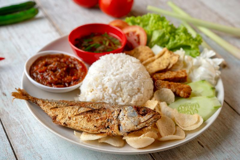 Fried mackerel fish rice. With sambal, popular traditional Malay or Indonesian local food royalty free stock photos