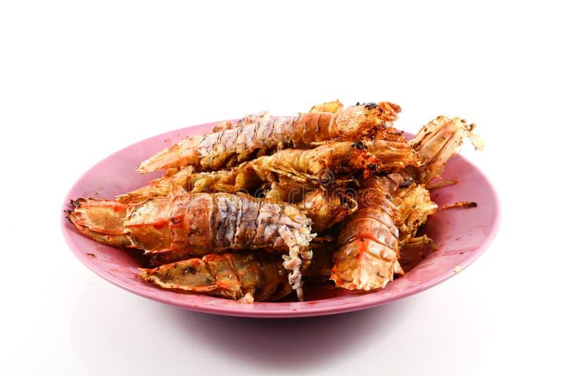 Fried Mantis-garnalen met knoflook en peper op witte achtergrond stock fotografie