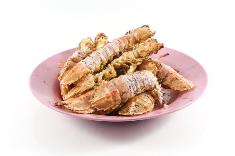 Fried Mantis-garnalen met knoflook en peper op witte achtergrond royalty-vrije stock afbeeldingen