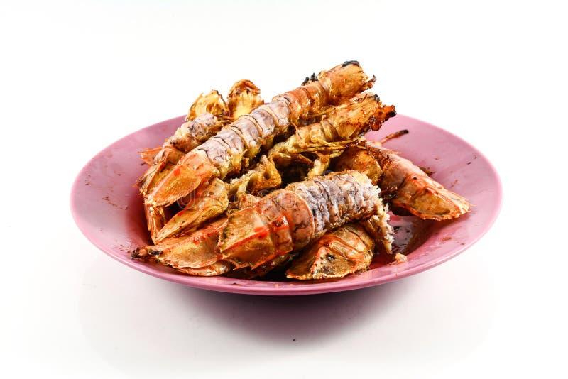 Fried Mantis-garnalen met knoflook en peper op witte achtergrond stock afbeelding
