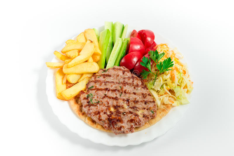 Fried meat balls with french fries and salad stock image