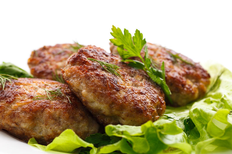 Fried meatballs with herbs royalty free stock images