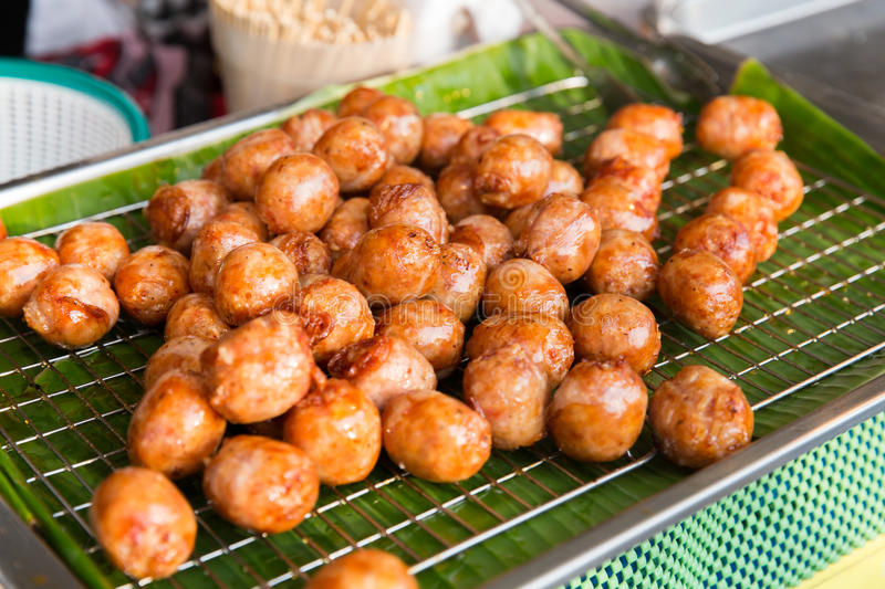 Fried meatballs sale at street market. Cooking, asian kitchen, sale and food concept - fried meatballs sale at street market stock photography