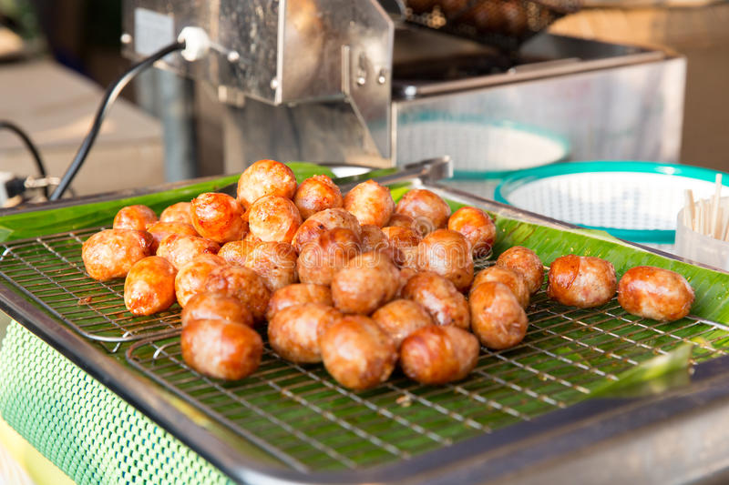 Fried meatballs sale at street market. Cooking, asian kitchen, sale and food concept - fried meatballs sale at street market stock photo