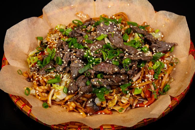 Fried noodle with beef. Asian cuisine - Fried noodle with beef royalty free stock photo