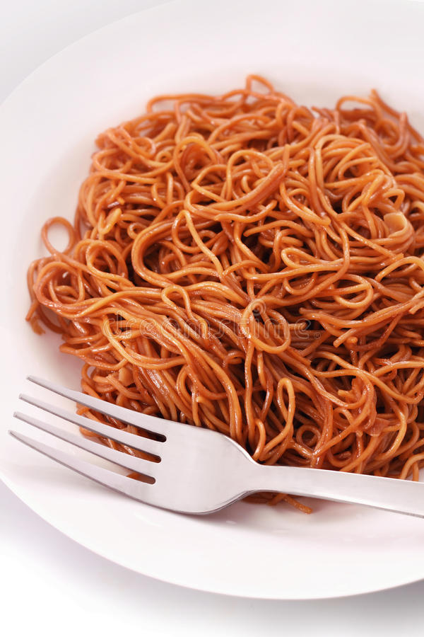 Fried Noodle. Delicious homemade fried noodle on the table stock image