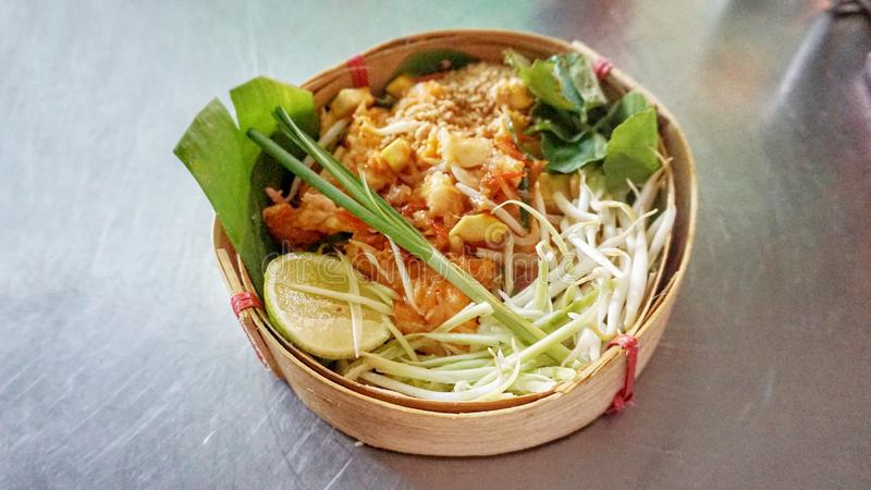 Close up Fried noodle Pad Thai in basket. Fried noodle Pad Thai in basket stock photo