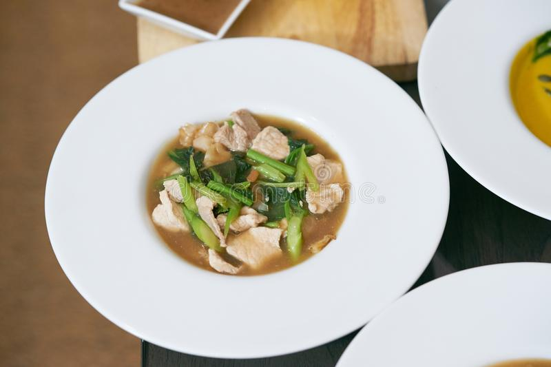 Fried noodle with pork and broccoli stock photo