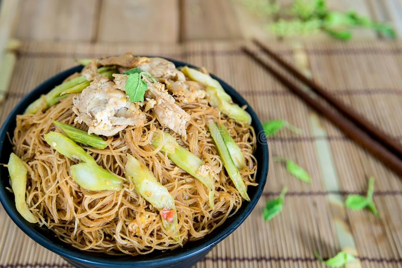 Fried noodle with pork meals. Fried noodle with pork appetizing placed on the dining table stock photography