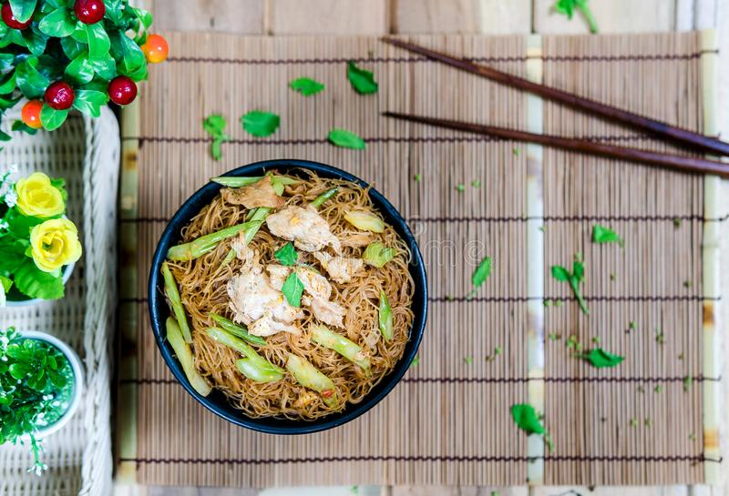 Fried noodle with pork on a straight plane. Fried noodle with pork and misaligned with the placement stock photography