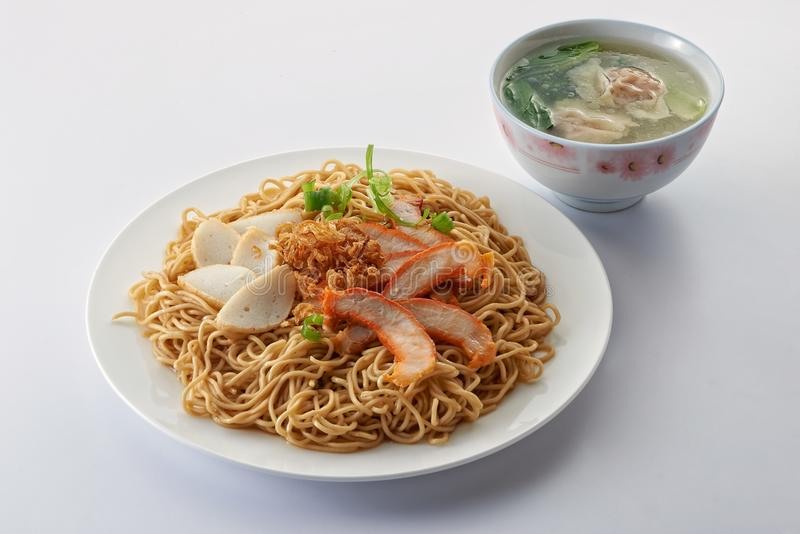 Fried noodle. With roast pork sliced fish cake minced pork and fishball soup on clean background stock photos