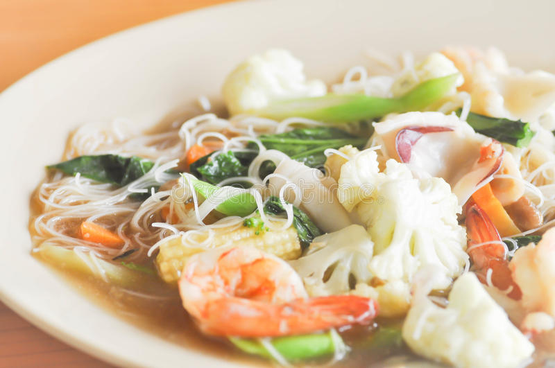 Fried noodle with squid , shrimp and vegetable or noodle stock images