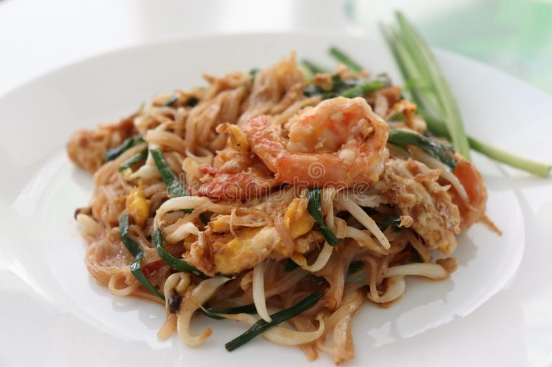Fried noodle Thai style with prawns, thai call padthai in white plate. Fried noodle Thai style with prawns in white plate royalty free stock photos