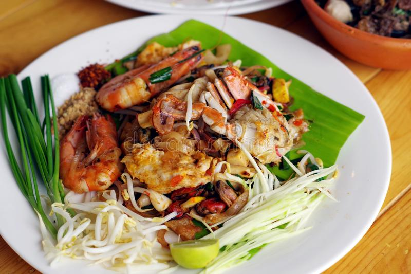 Fried noodle Thai style on a white plate stock photos