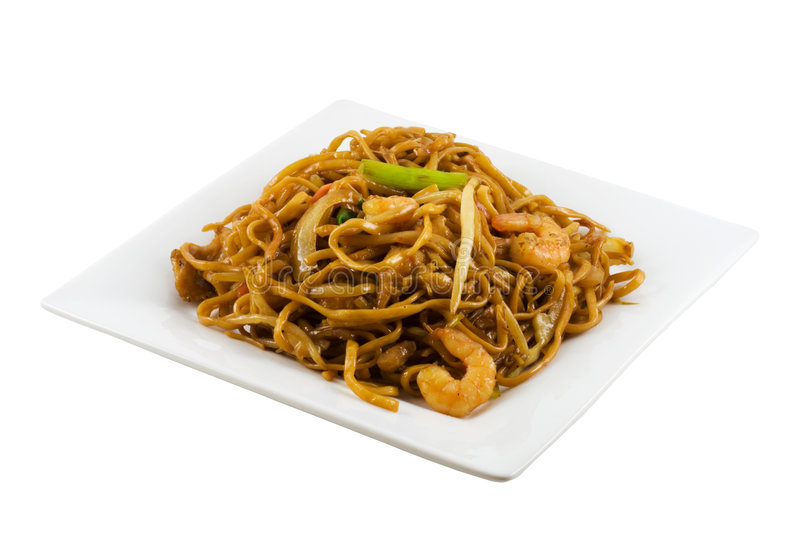 Fried Noodles. A plate of fried noodles isolated in solid white background