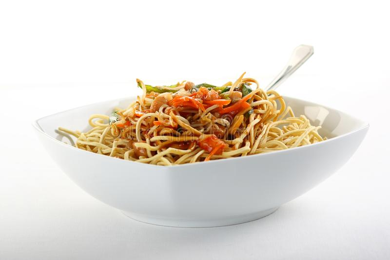 Fried noodles in bowl. On white background stock image