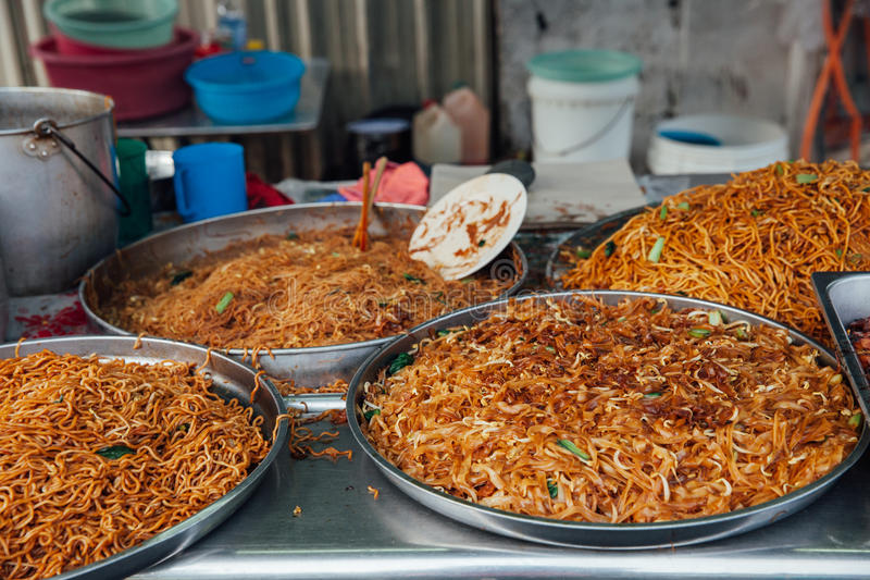 Fried noodles at the Kimberly Street Food Market. Kway teow fried noodles at the Kimberly Street Food Night Market, George Town, Penang, Malaysia royalty free stock photos