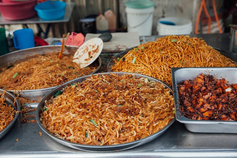 Fried noodles at the Kimberly Street Market, Penang. Kway teow fried noodles at the Kimberly Street Food Night Market, George Town, Penang, Malaysia royalty free stock photo