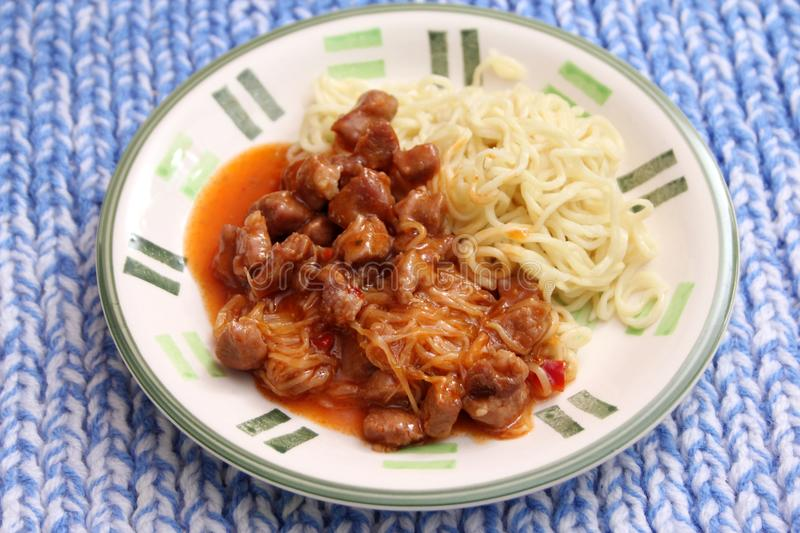 Fried noodles with pork meat royalty free stock photo