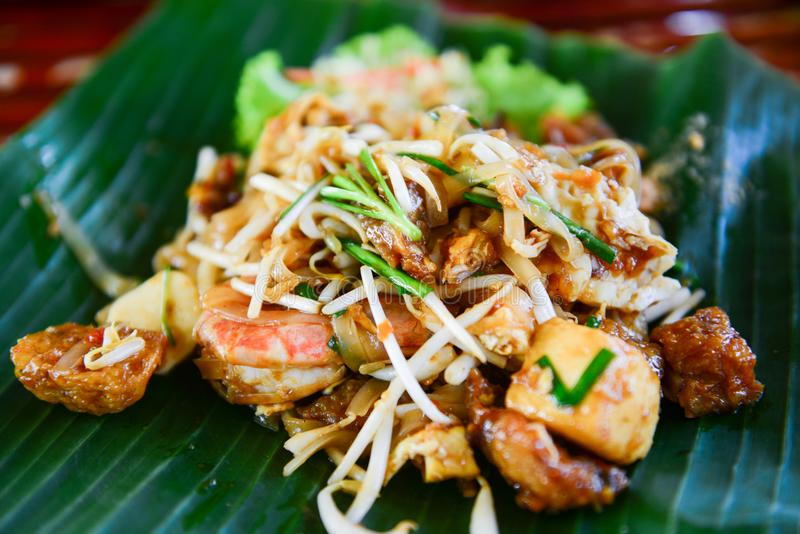Fried noodles with shrimp or pad thai. Popular thai food royalty free stock photo