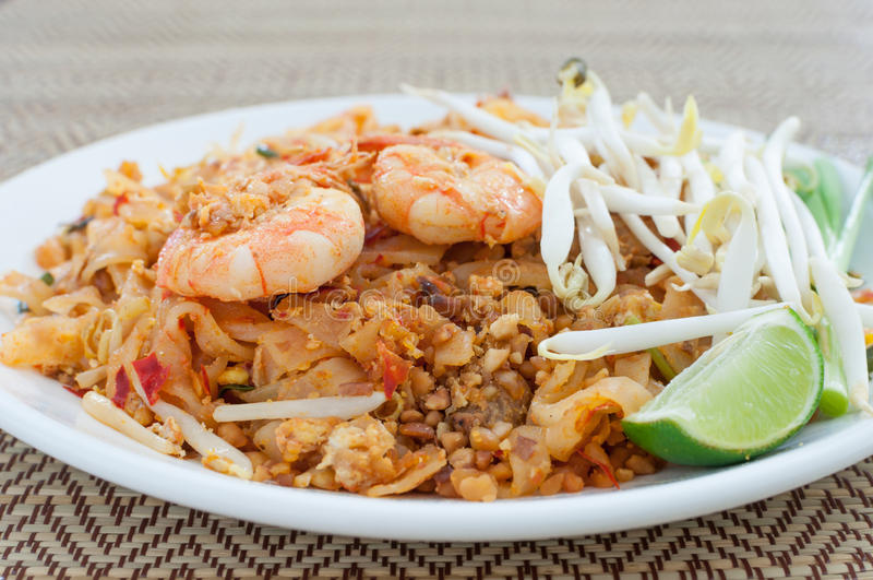 Fried noodles thai style with prawns (pad thai). Stir-fried thai noodles royalty free stock photography