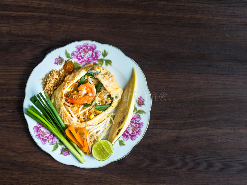 Fried Noodles wrapped with eggs Phad Thai stock photo