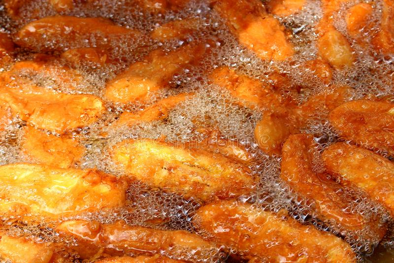 Fried in oil bananas background stock photo