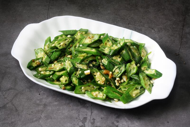 Fried okra or ladies finger,. Simple stir fry asian food. Served in rectangle plate stock image