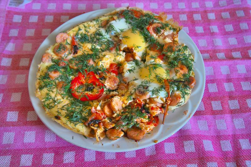 Fried omelet with tomatoes royalty free stock images