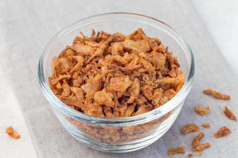 Fried onion in glass, topping for hot dog, fast food, horizontal. Fried onion in the glass, topping for hot dog, fast food, horizontal salt vegetable background stock photo