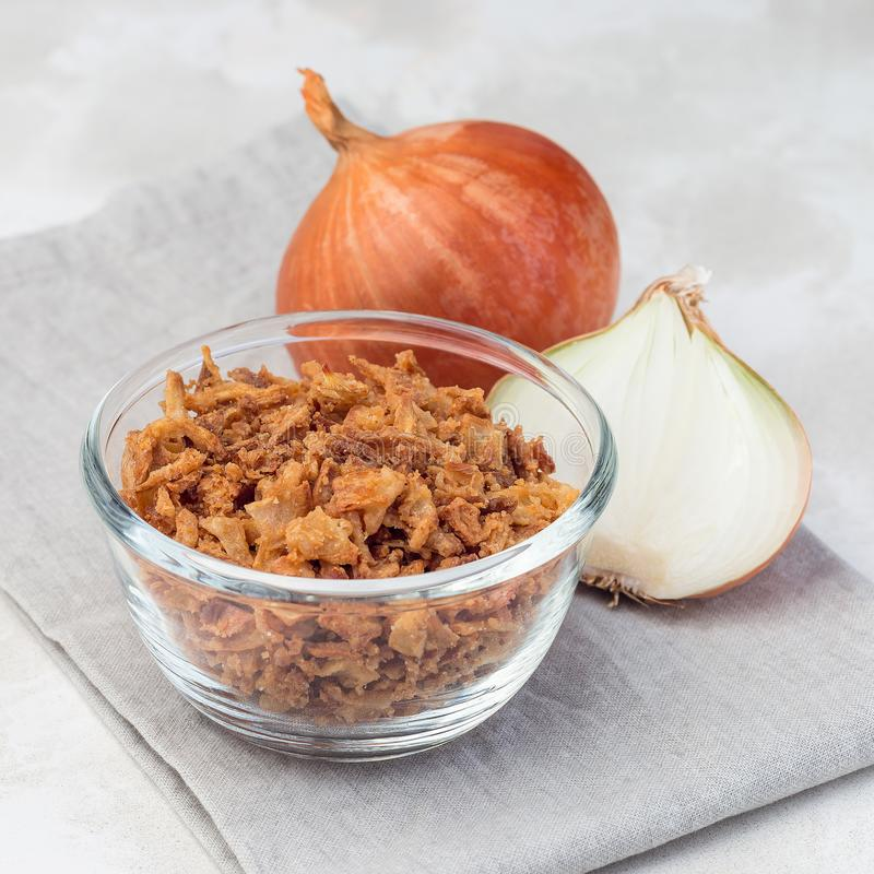 ,,Fried onion in glass, topping for hot dog, fast food, square format. Fried onion in the glass, topping for hot dog, fast food, square format salt vegetable royalty free stock photos