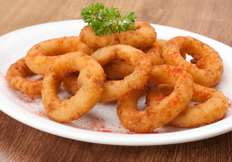 Fried onion rings. Snack on plate royalty free stock images