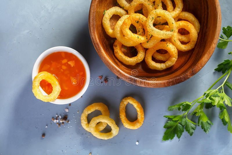 Fried onion rings. In batter with sauce. Food background, Top view stock photo