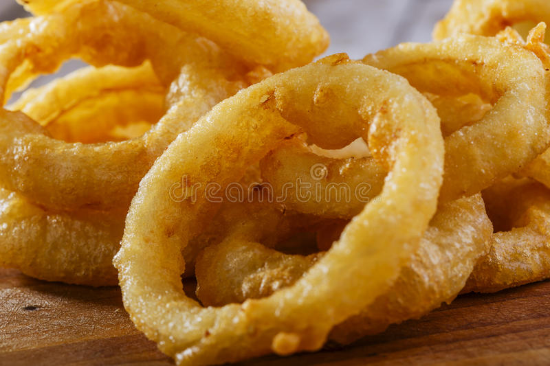 Fried onion rings. With red sauce royalty free stock image