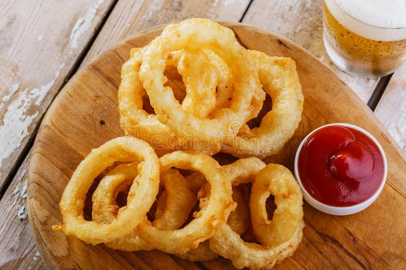Fried onion rings. With red sauce royalty free stock photo