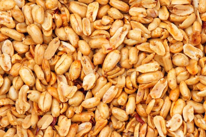 Fried peanut kernels. The background of fried peanut kernels stock photos