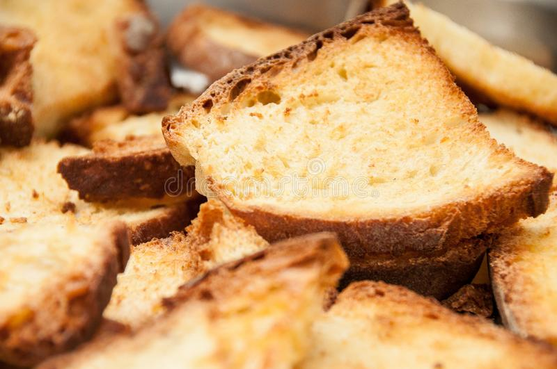 Fried pieces of bread royalty free stock photo
