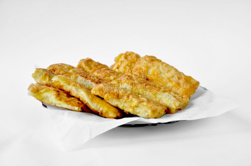 Fried pies with filling on a white plate. On a white background stock photography