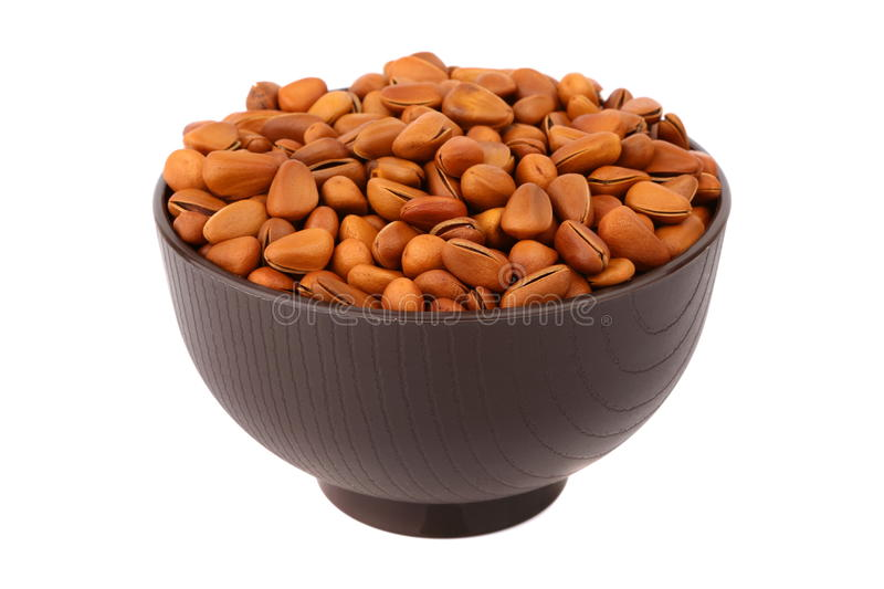 Download Fried pine nut in the bowl stock image. Image of isolated - 29838605