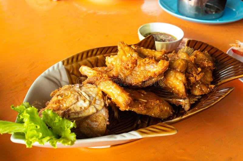 Fried Pomegranate fish With seafood sauce and vegetables. stock image