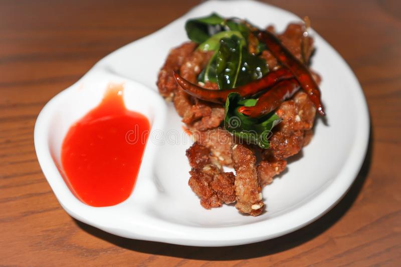 Fried pork with chili sauce. Deep fried pork with chili sauce royalty free stock photo
