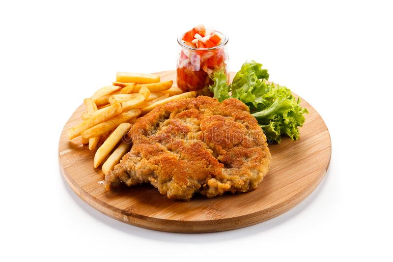 Fried pork chop with french fries. On white background royalty free stock photography