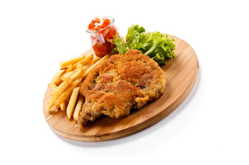Fried pork chop with french fries. On white background stock photo