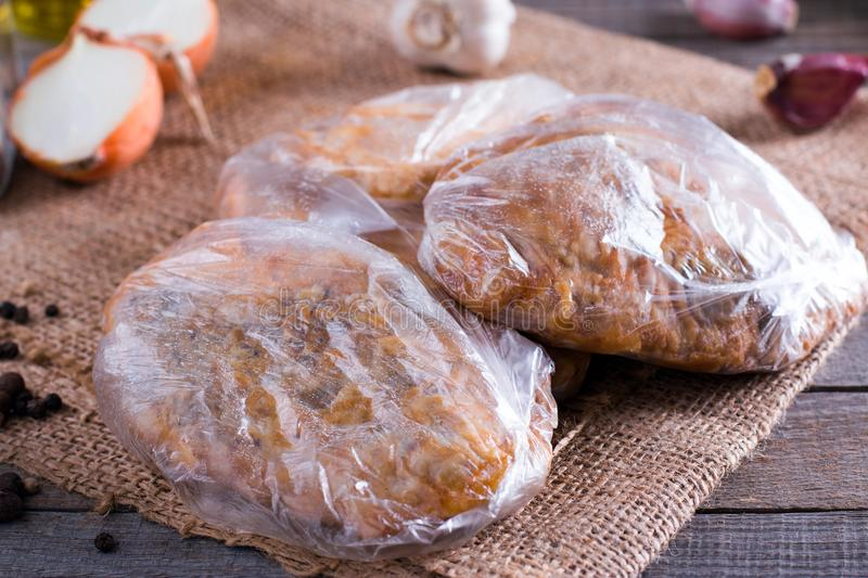 Fried pork fillet in a bag on the table stock photos