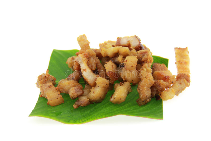 Fried Pork with Garlic Pepper on banan leaf. Fried Pork Garlic Pepper banan leaf royalty free stock image