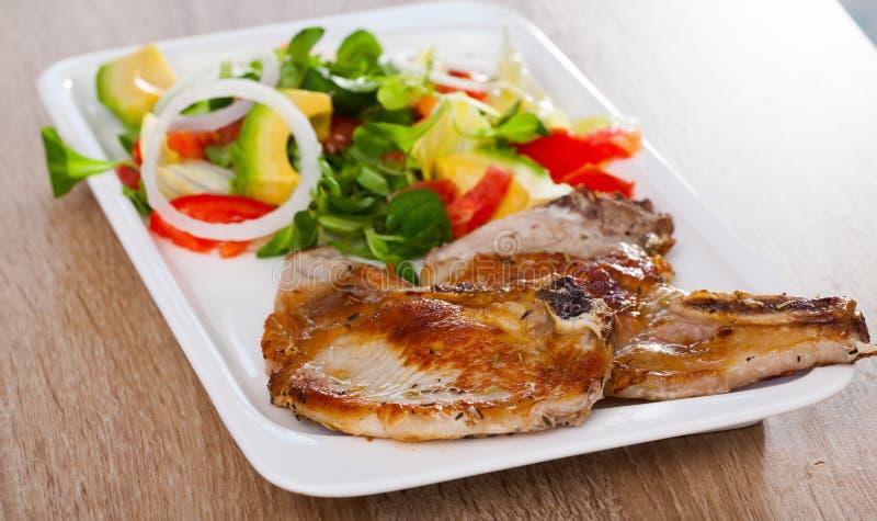Fried pork loin with salad royalty free stock photos