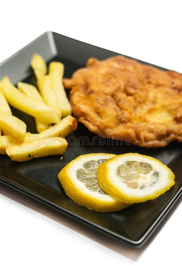 Fried pork meat steak with lemon on the plate stock photos